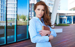 Businesswoman standing in front of office buildings Royalty Free Stock Photo