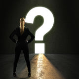 Businesswoman standing in front of a portal shaped as a questionmark Stock Photography