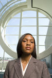 Businesswoman standing in front of round window Royalty Free Stock Photos