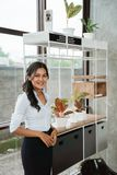 Businesswoman standing in front the shelves royalty free stock photos