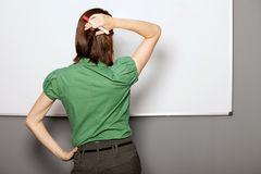Businesswoman standing in front of whiteboard in office Royalty Free Stock Photo