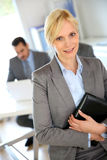 Businesswoman standing in grey suit Royalty Free Stock Image