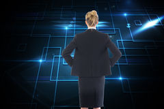 Businesswoman standing with hands on hips Royalty Free Stock Image