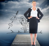 Businesswoman standing with hands on hips Stock Images