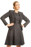 Businesswoman standing with hands on hips Royalty Free Stock Images