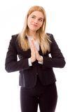 Businesswoman standing with hands joined Royalty Free Stock Image