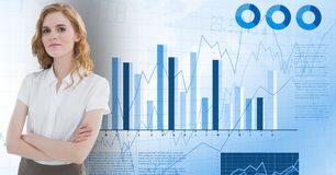 Businesswoman standing with her arms crossed against bar graph analysis background Royalty Free Stock Images