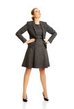 Businesswoman standing with her hands on hips Stock Image