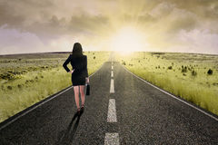 Businesswoman standing on the highway road 3 Royalty Free Stock Photography