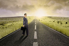 Businesswoman standing on the highway road 5 Royalty Free Stock Photo