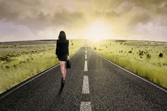 Businesswoman standing on the highway road 2 Royalty Free Stock Photos