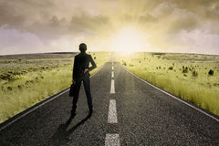 Businesswoman standing on the highway road 1 Stock Photography