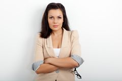 Businesswoman standing and holding eyeglasses Royalty Free Stock Photography