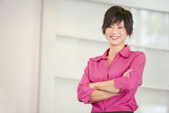 Businesswoman standing indoors Royalty Free Stock Photo