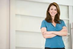 Businesswoman standing indoors Stock Image