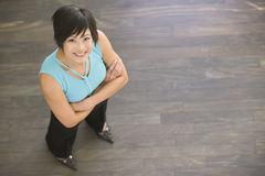 Businesswoman standing indoors smiling Royalty Free Stock Photo