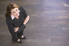 Businesswoman standing indoors smiling Stock Photo