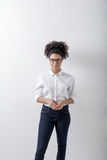 Businesswoman standing indoors. At white wall royalty free stock images