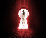 Businesswoman standing in the keyhole doorway Royalty Free Stock Photography