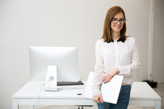 Businesswoman standing with laptop Royalty Free Stock Photo