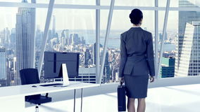 Businesswoman standing and looking at office window stock footage