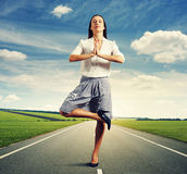 Businesswoman standing in meditation asana Stock Photos