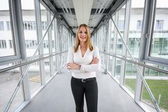 Businesswoman standing in a modern Building Royalty Free Stock Image
