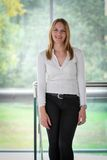 Businesswoman standing in a modern Building Stock Image