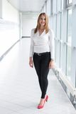 Businesswoman standing in a modern Building Royalty Free Stock Images