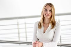 Businesswoman standing in a modern Building royalty free stock photo
