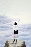 Businesswoman standing on the mountain peak Royalty Free Stock Photos
