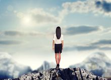 Businesswoman standing on mountain top Royalty Free Stock Photo