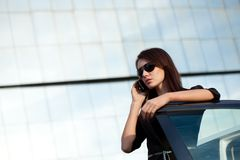 Businesswoman standing near car Stock Image