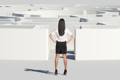 Businesswoman standing near labyrinth entrance Stock Photography