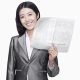 Businesswoman standing with newspaper Royalty Free Stock Photo