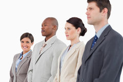 Businesswoman standing next to her colleagues Stock Images