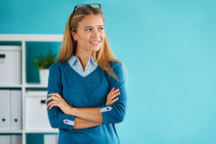 Businesswoman standing in office Stock Image
