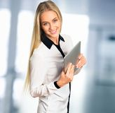 Businesswoman with electronic pad royalty free stock photo