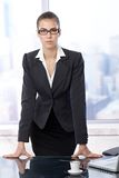 Businesswoman standing at office table Royalty Free Stock Photos