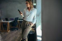 Female entrepreneur using mobile phone stock photo