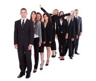 Businesswoman standing out from the crowd Royalty Free Stock Images
