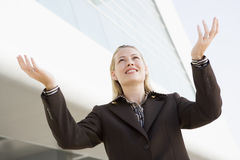 Businesswoman standing outdoors by building Stock Photography