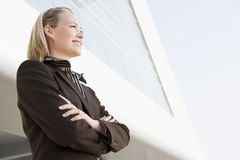 Businesswoman standing outdoors by building Royalty Free Stock Photos