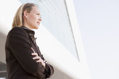 Businesswoman standing outdoors by building Royalty Free Stock Image