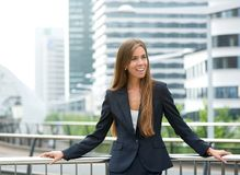 Businesswoman standing outdoors in the city Royalty Free Stock Images