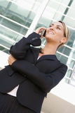 Businesswoman standing outdoors using mobile phone Royalty Free Stock Photos