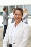 Businesswoman standing outside Royalty Free Stock Photography