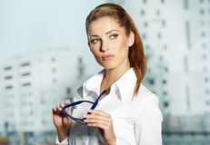 Businesswoman standing outside a house Stock Images