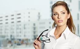 Businesswoman standing outside a house Royalty Free Stock Image