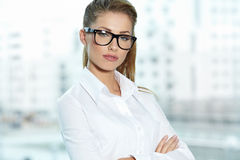 Businesswoman standing outside a house Stock Image